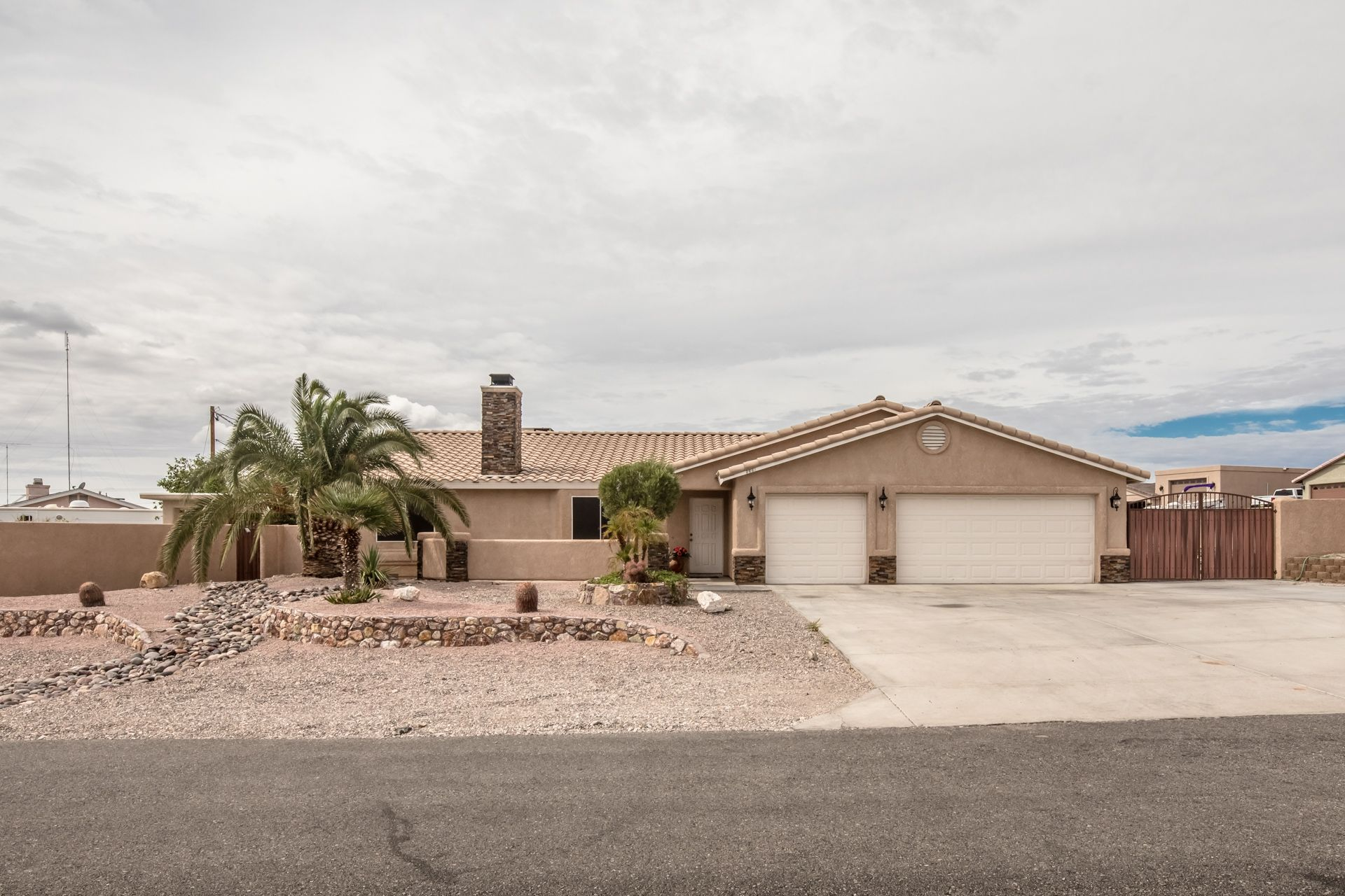 Updated Home On A Corner Lot With A 3 Car Garage, Block Wall And A