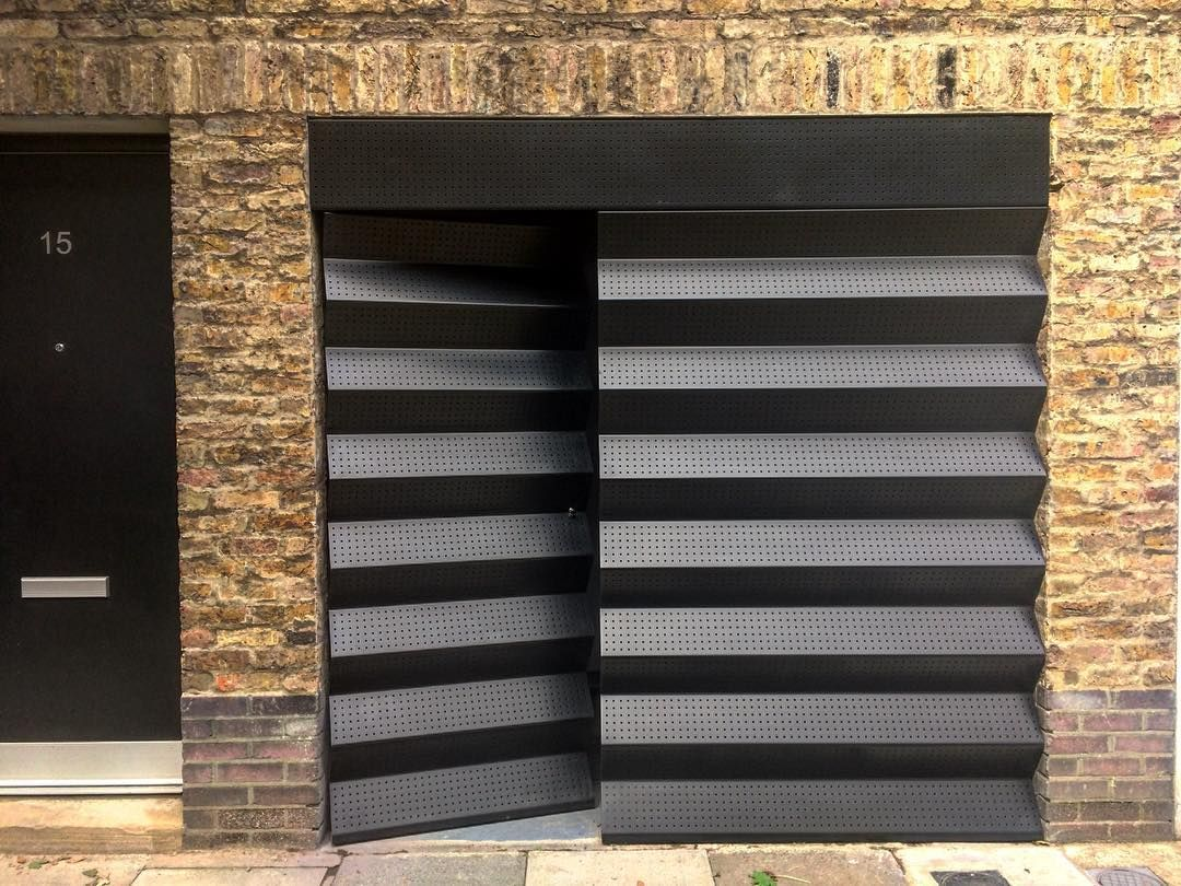 Installation Of A Garage Door With Fixed Panel Perforated