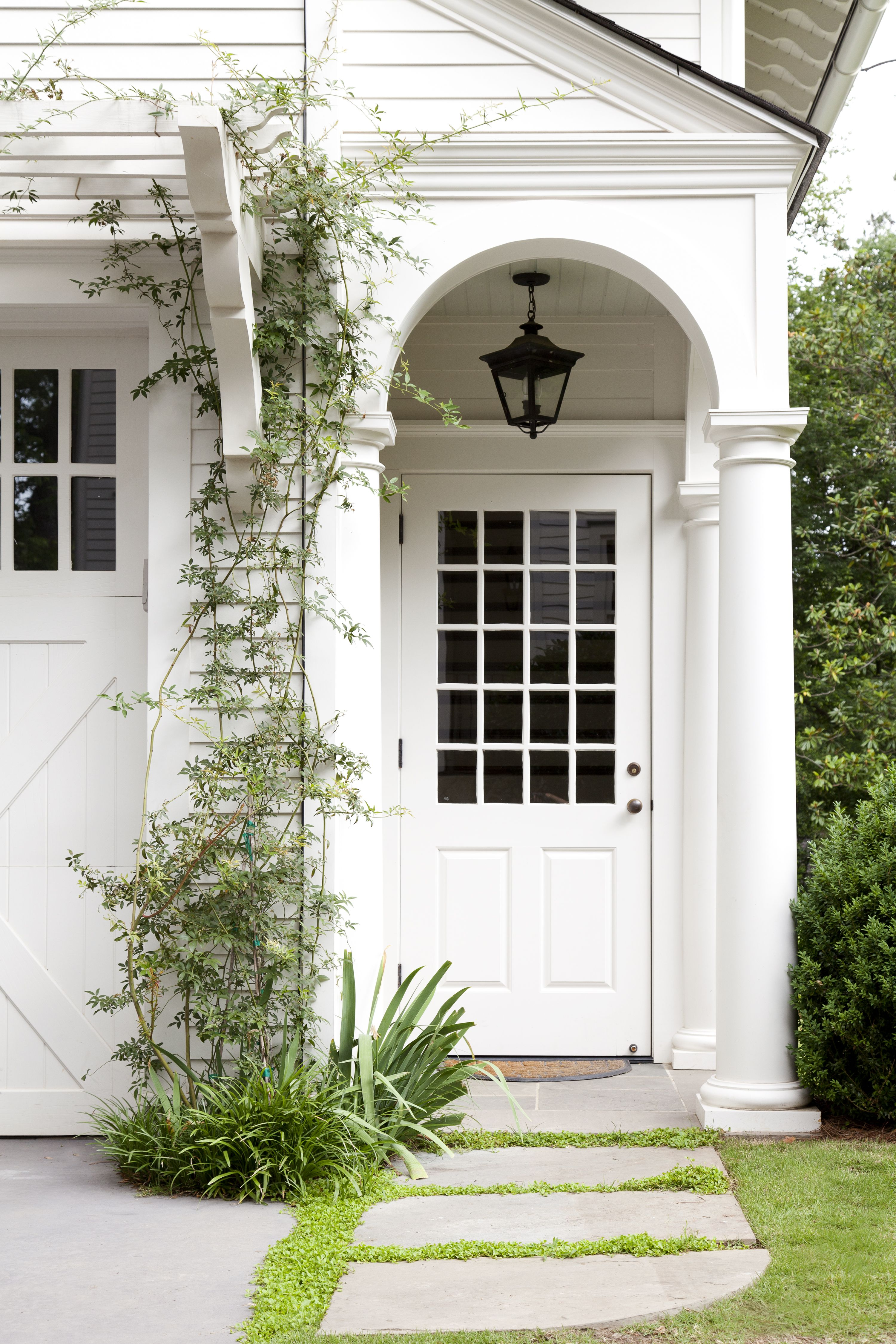 Carriage House Entry Porch • Trellis Over Garage Doors | Exterior In
