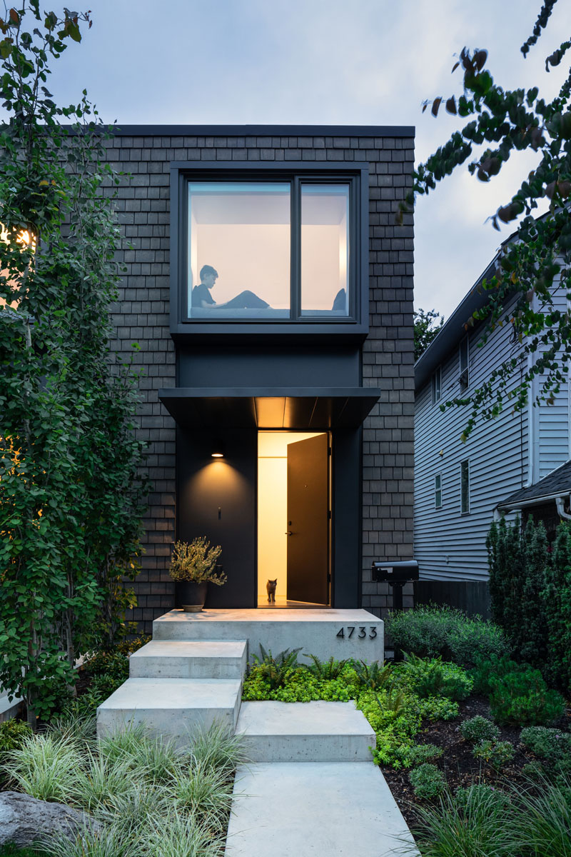 A Sunken Garage Allows This New House To Remain At Eye Level